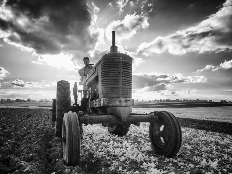 Black and white 1940s tractor in field