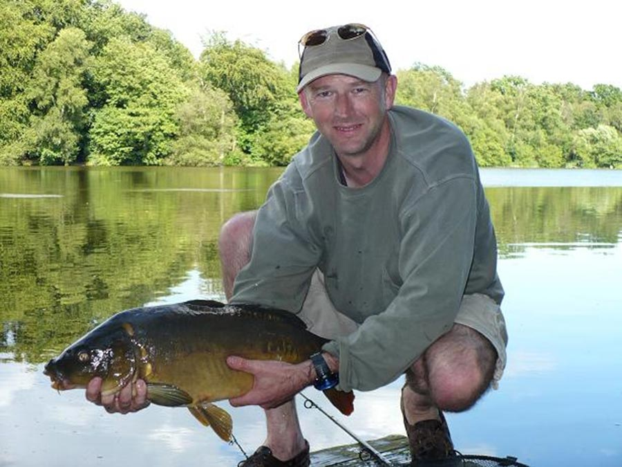Philip Clarke with a just-caught carp