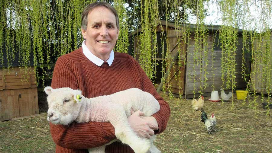 Man holding lamb in his arms