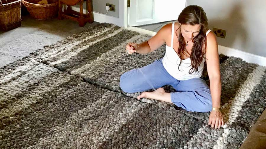 Elizabeth Kneafsey at work on one of her rugs
