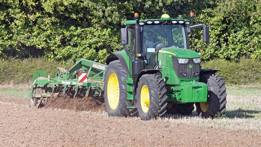 John Deere 6175R working in field