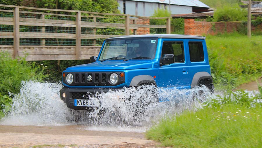 Suzuki driving through water
