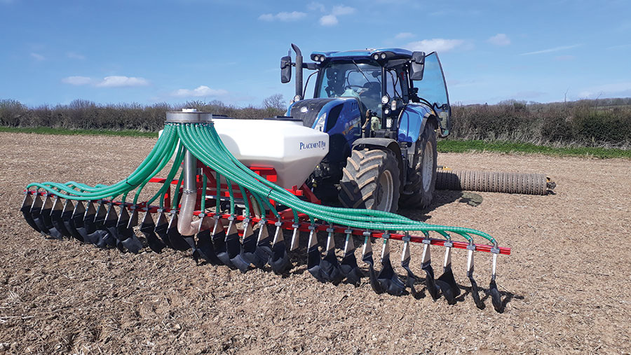 Custom-built Techneat applicator for broadcasting cover crop