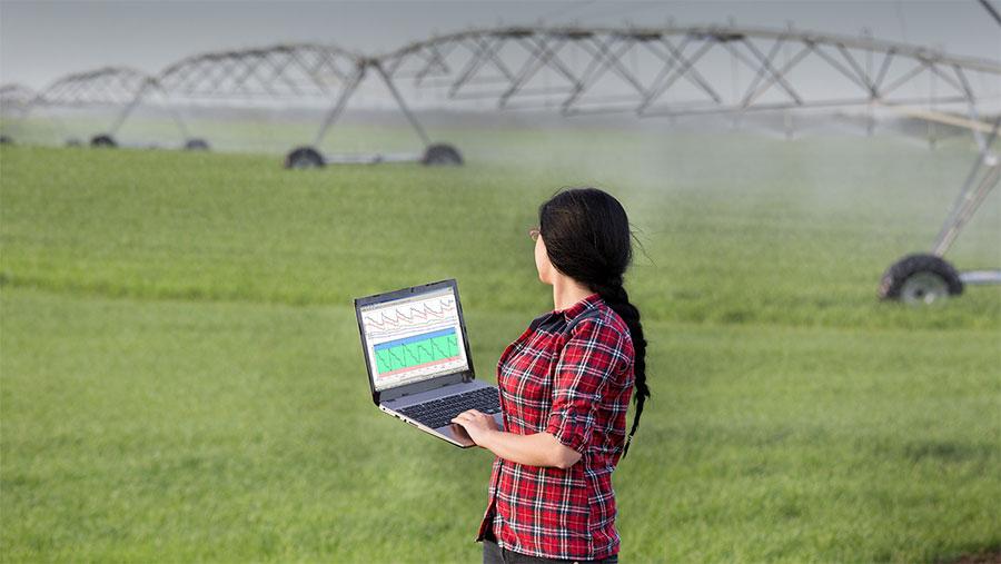 Farmworker using Sentek in field