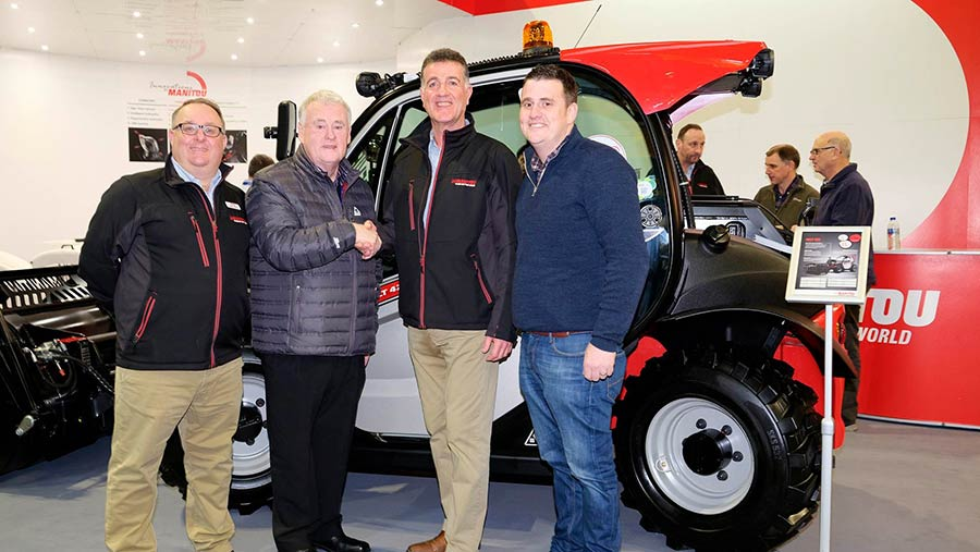 Glyn Lord and Manitou representatives with a Manitou telehandler