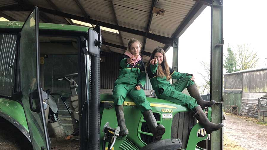 Two ladies sitting on tractor