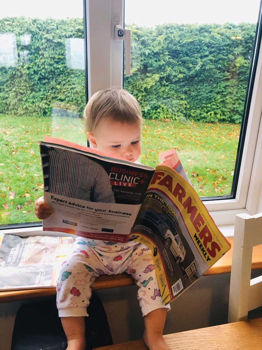 One-year-old reading Farmers Weekly