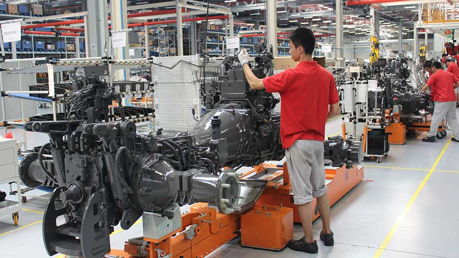Engine and powertrain being assembled