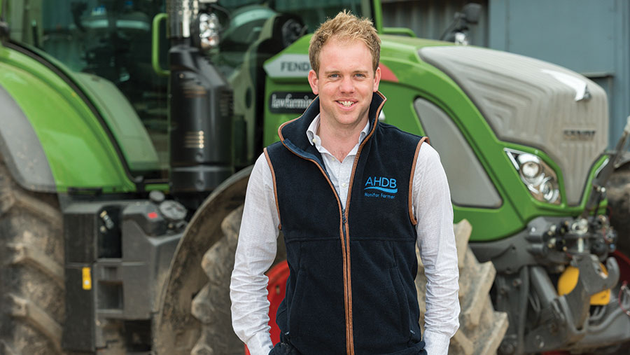 David Hurst standing in front of a tractor