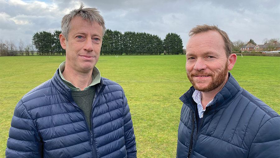 Ralph Parker and Matt Doggett standing in a field