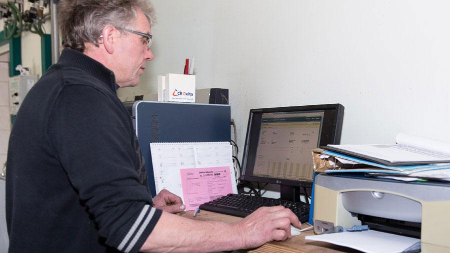 Mr Versteeg at his computer