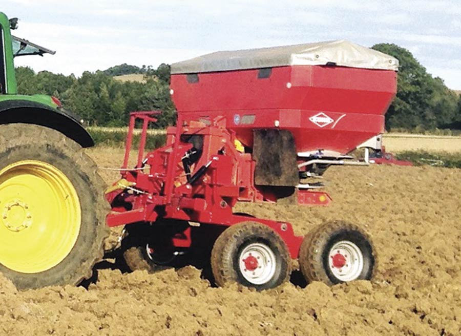 Fertiliser spreader in a field