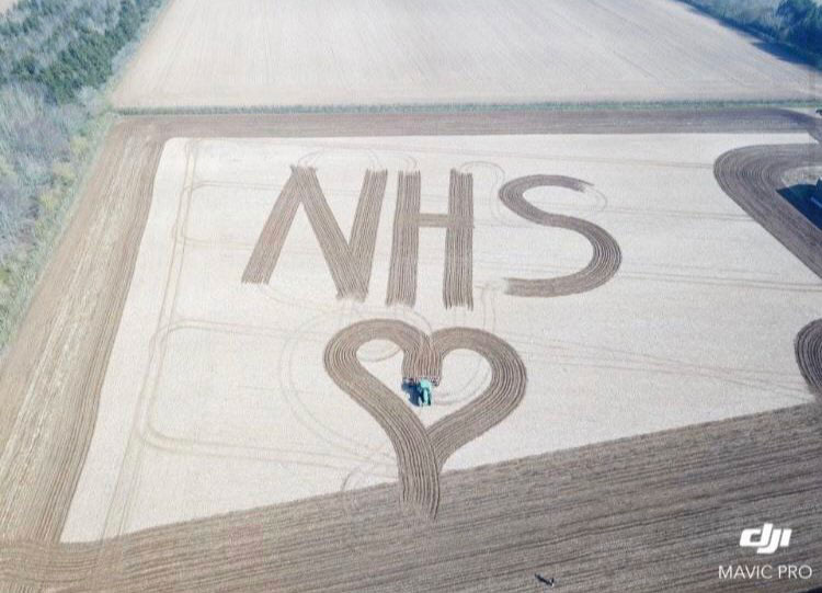 NHS and heart mowed into field