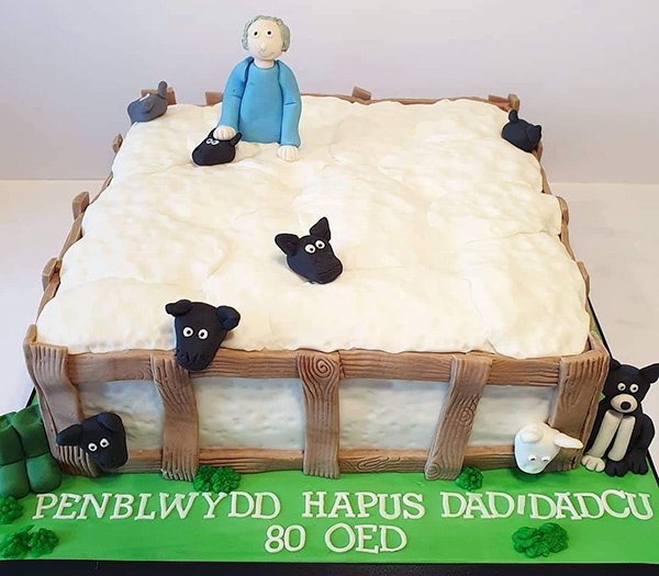 Sheep and Farmer in pen cake