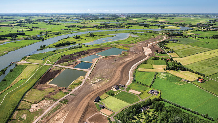 Aerial view of a floodplain being widened to take more water