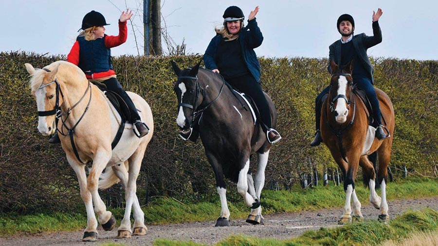 Izzie, Ashleigh and Chris riding horses