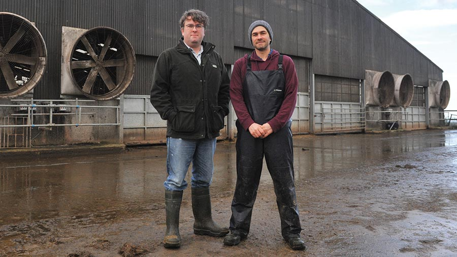 Tom (left) and Marc Allison in the dairy shed