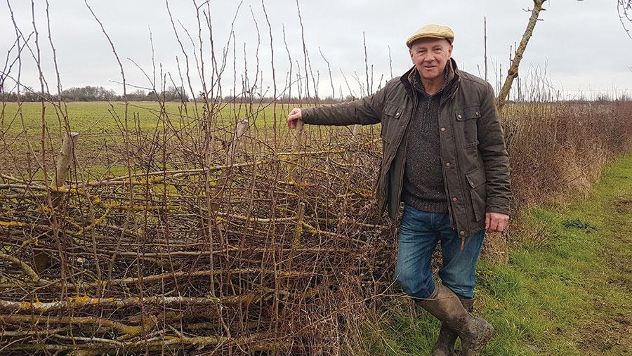 Tim Scott standing in field