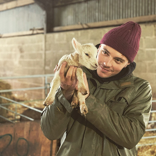 Man holding lamb
