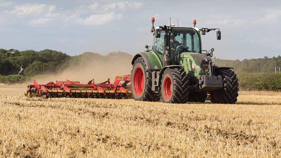 Tractor cultivating field