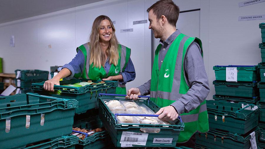 FareShare staff sorting the donated food
