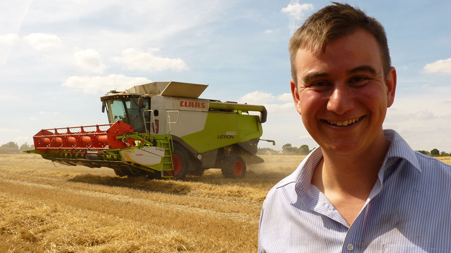 George Young with combine in the background