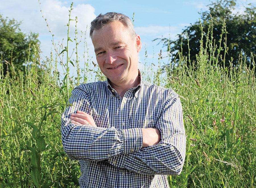 Ian Wilkinson standing in field