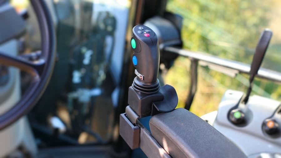 Joystick on armrest in tractor cab