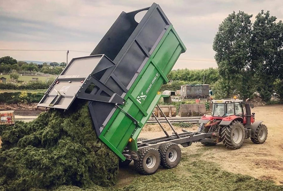 Heath grain and sIlage trailer tipping out silage