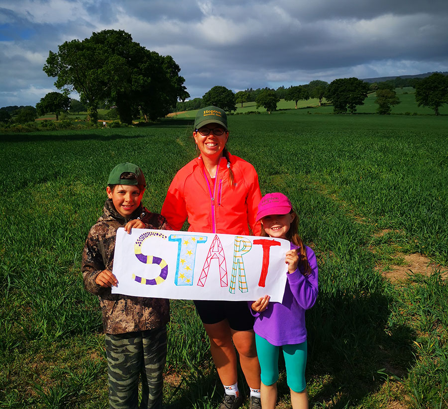 Runner and family with start sign