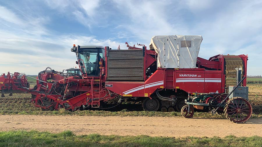 The Ivel is dwarfed by a modern Grimme potato harvester