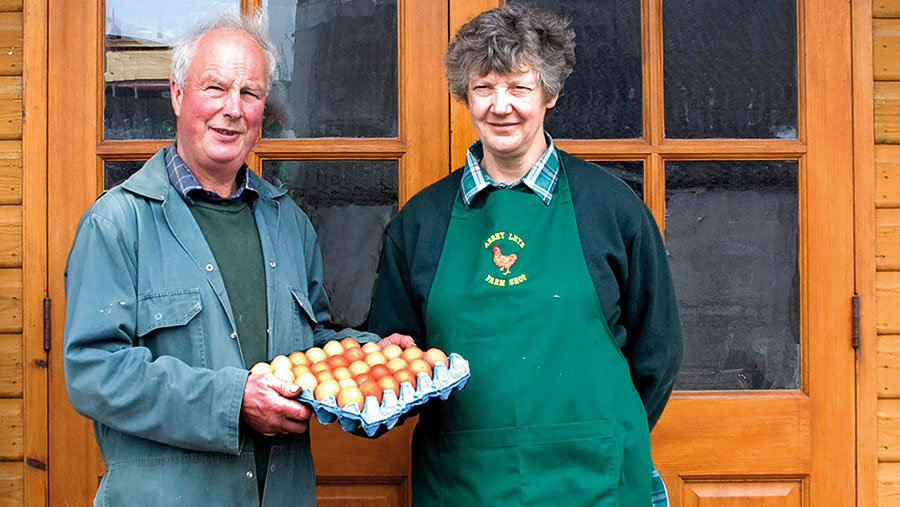 Tim and Janet  Harrison in front of shop with tray of eggs