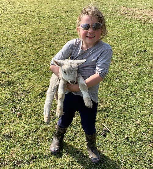 Olivia holding a lamb