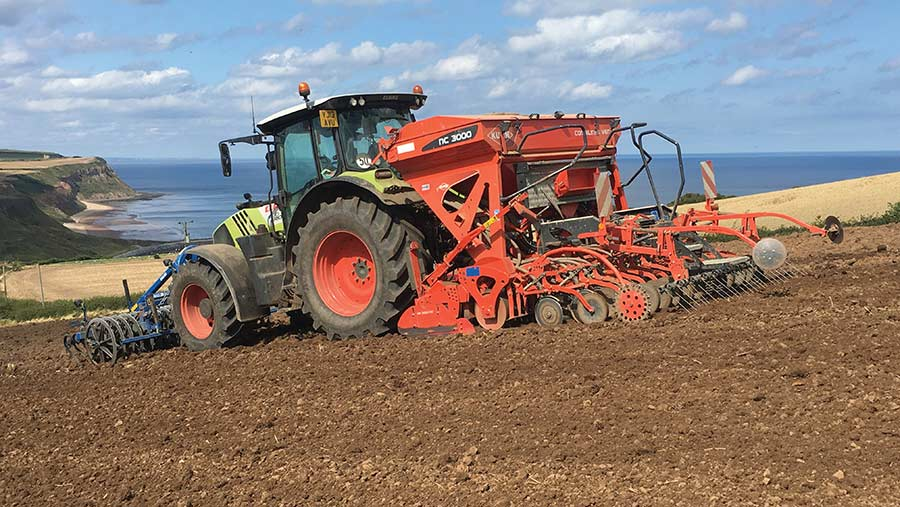 The Claas Arion 650 drilling on the North Yorkshire coast