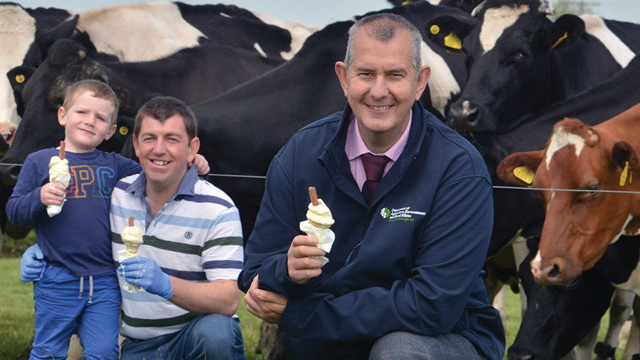 Rural affairs minster Edwin Poots with Stephen Gibson and son Stuart at their Hollowbridge Farm in County Down