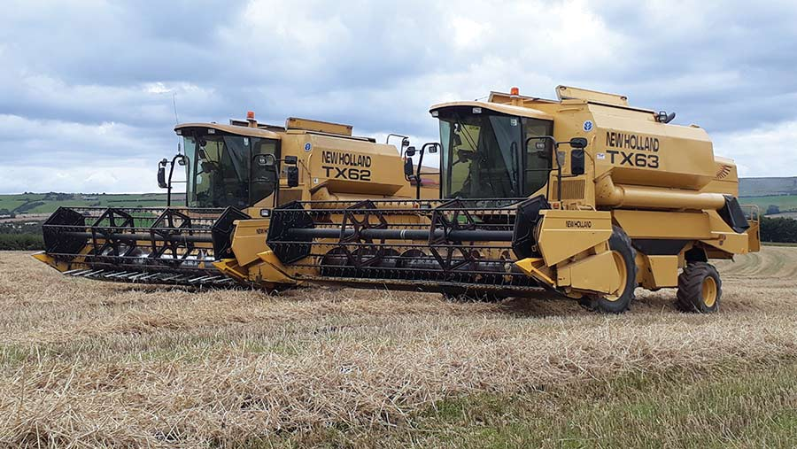 Two New Holland combines