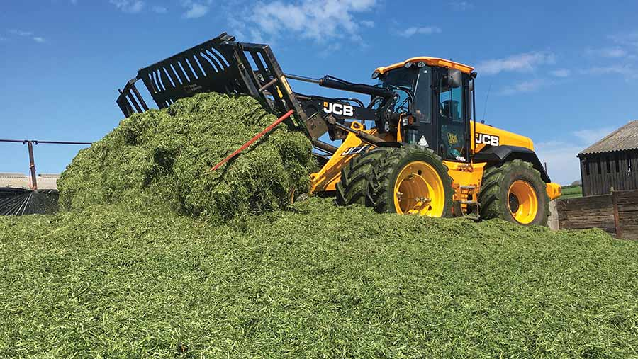 JCB 416S loader on top of silage clamp