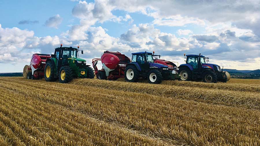 Three tractors with balers