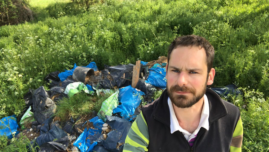 Richard Heady in the field with fly-tipped
