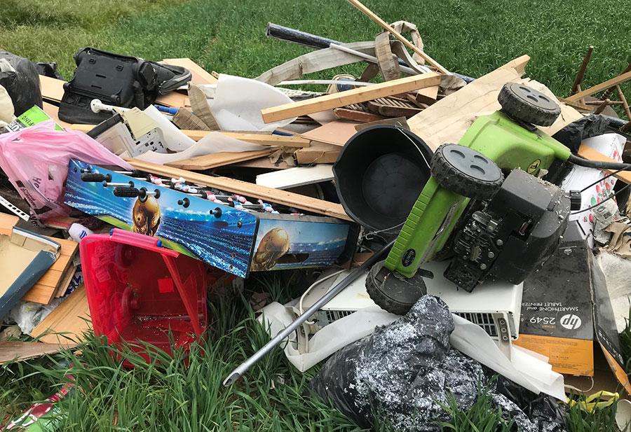 Flytipped waste in field