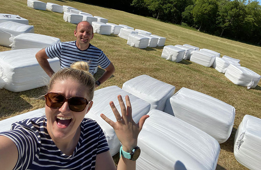 Mark Howard-Smith and Lucy with the hay bales