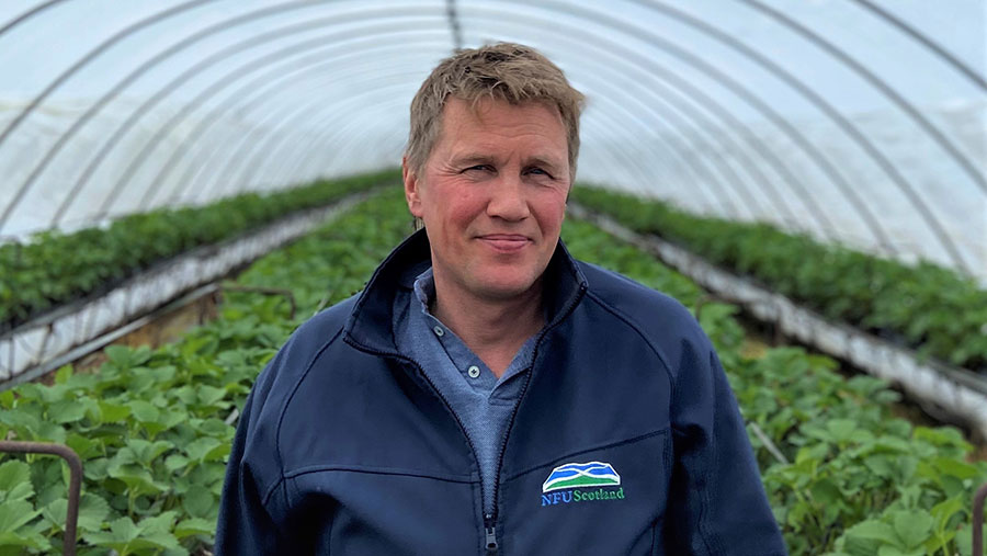 James Porter in a greenhouse