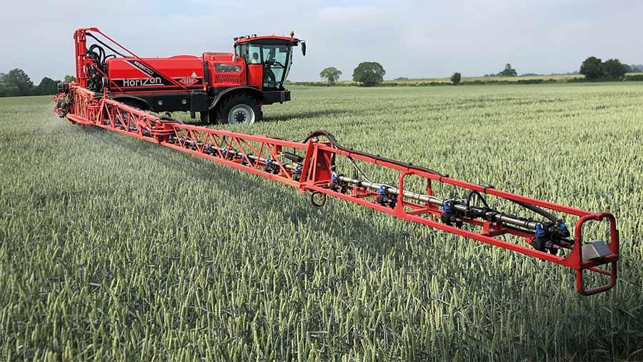Sands sprayer in crop
