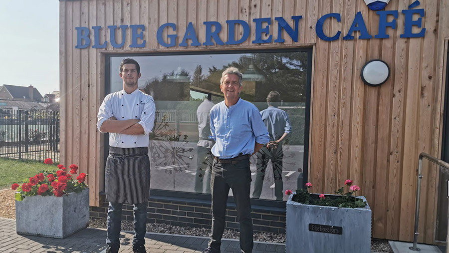 Guy Smith (right) with son Henry, the chef, outside the farm's cafe