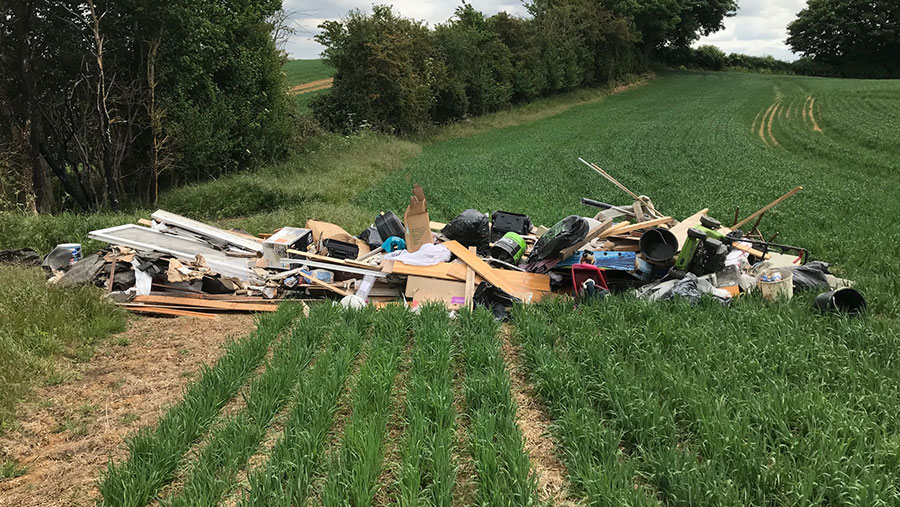 Fly-tipped waste in field