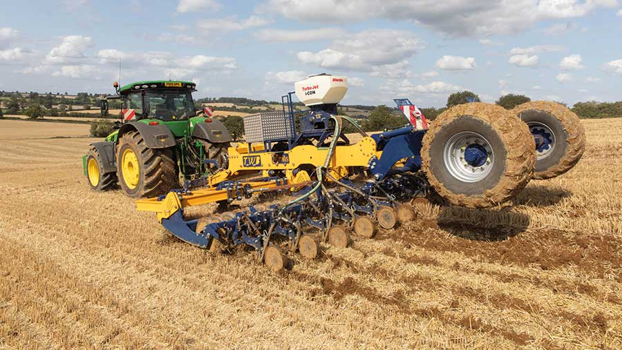 Tractor and trailled drill drilling OSR