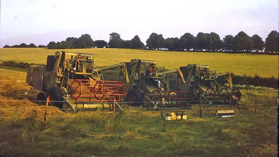 A young Charlie Flindt sat on an old combine harvester