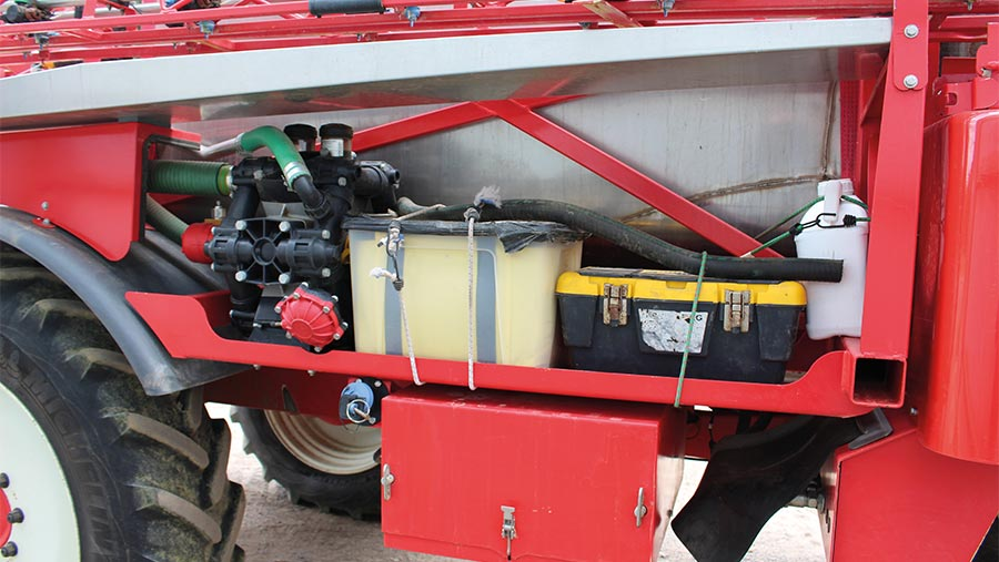 Bungy straps securing toolboxes on Bateman sprayer