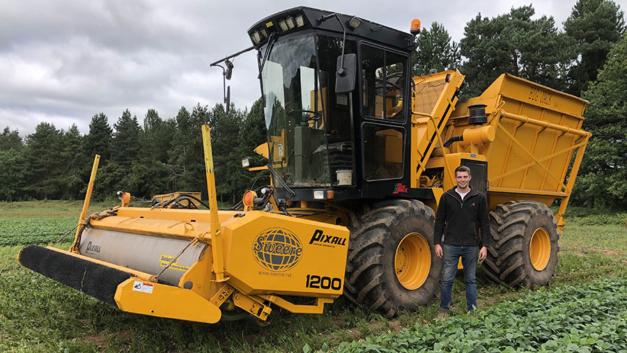 Alex-Baylis with the farm's self-propelled bean harvester