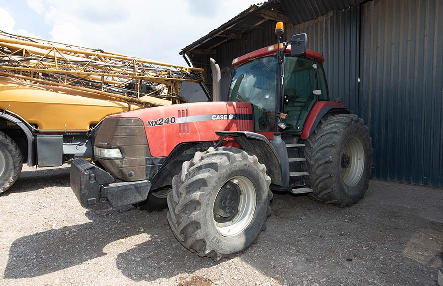 Tractor in front of barn